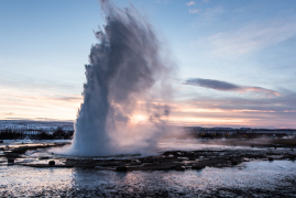 Geysir erruption at sunrise in Reykholt, ISL